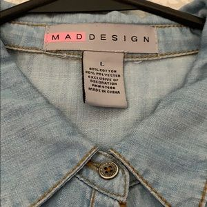 Button up blue jean top w/ slit down the bottom.